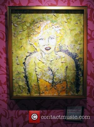 Monroe Photograoher Sues