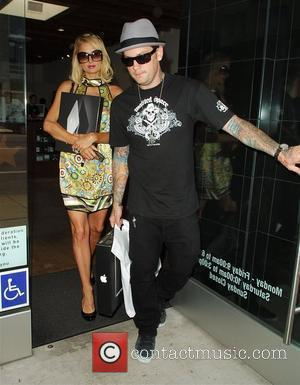 Benji Madden purchases a Macbook for himself and Macbook Air for Paris Hilton at an Apple store in West Hollywood...