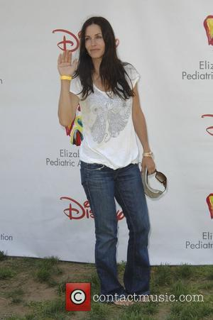 Courteney Cox,  Time for Heroes celebrity carnival to benefit The Elizabeth Glaser Pediatic Aids Foundation.  Los Angeles, California...