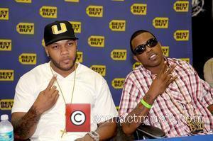 FLo Rida and Brisco DJ Khaled signs copies of his new CD 'We Global' at BestBuy Pembroke Pines, Florida -...