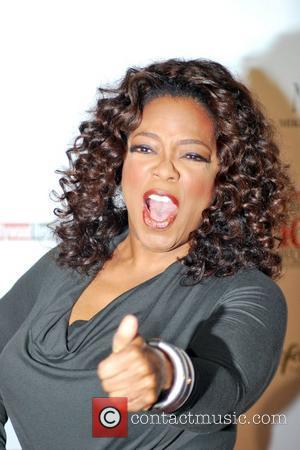 Winfrey 'Embarrassed' By Weight Gain