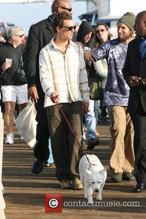 Matthew McConaughey walking his dog at the Surfrider Art and Music Festival on Malibu Pier. Matthew joined the band for...
