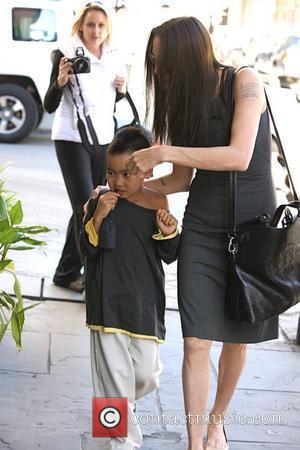 Jolie-pitt Family Love New Orleans