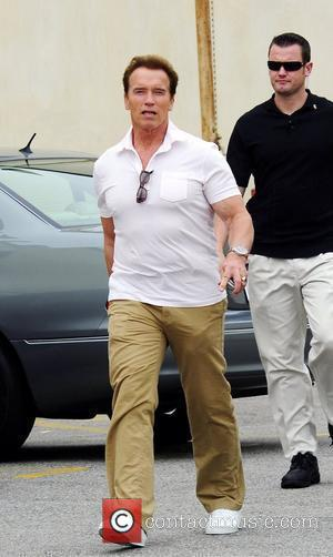 Arnold Schwarzenegger leaving a restaurant after having lunch with his family in Brentwood Los Angeles, California - 02.05.09