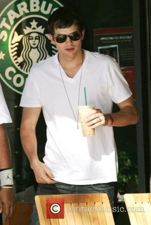 Ashton Kutcher stops by Starbucks coffee in Beverly Glen Market with a friend to pick up a Frappuccino. Los Angeles,...