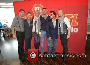 Shane Lynch, Mikey Graham, Juliane Rasche, Keith Duffy, Stephen Gately and Ronan Keating visit 104.6 RTL Radio station in Berlin....