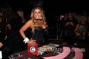 Carmen Electra as a Celebrity Bunny Dealer at the Playboy club in the Palms Hotel and Casino Las Vegas, Nevada...