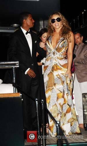 Mariah Carey and husband Nick Cannon leaving Roberto Cavalli's yacht during the 2009 Cannes International Film Festival - Day 4...