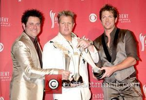 Rascal Flatts Fan Pulls Guitarist Offstage