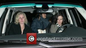 Courtney Cox Arquette  leaving Il Sole restaurant with her husband and daughter Los Angeles, California - 26.12.08