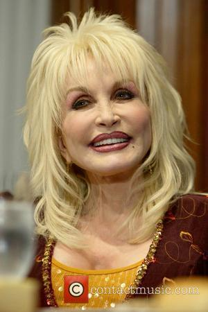 Dolly Parton speaks at a National Press Club luncheon as part of her duties as ambassador for the Great Smoky...