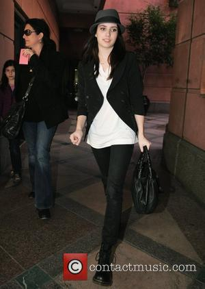 Emma Roberts at a medical center in Beverly Hills wearing a Trilby hat and Dr. Martens boots. Los Angeles, California,...