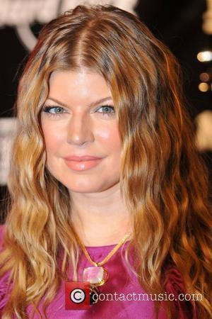 Fergie Packs On The Pounds With Fish Suppers