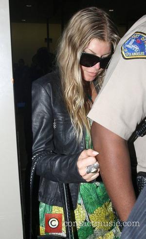 Fergie: 'No Baby Plans Until After Tour'