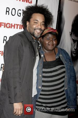 Lee Daniels and Gabourey 'Gabby' Sidibe at the premiere of 'Fighting' at the Regal Union Square Stadium 14 - Arrivals...