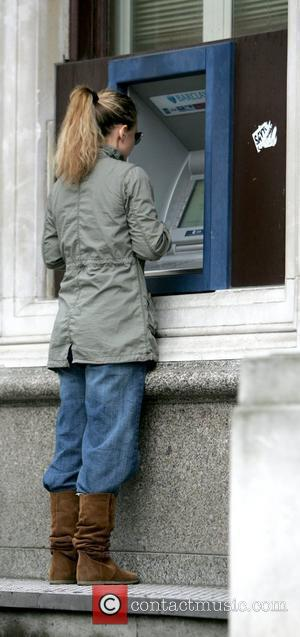 Geri Halliwell withdraws money while out and about with her daughter in London.  Lodnon, England - 17.04.09