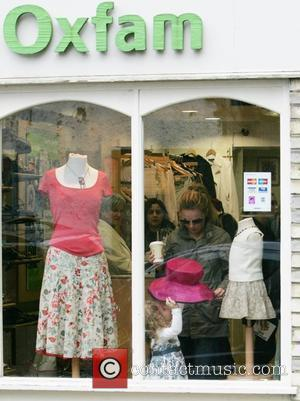 Geri Halliwell lets her daughter Bluebell Madonna Halliwell try on a large pink hat while shopping in Oxfam London, England...