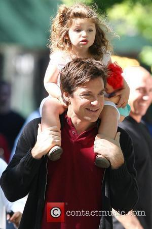 Jason Bateman carries his daughter, Francesca, on his shoulders while on break at the film set of his new movie...