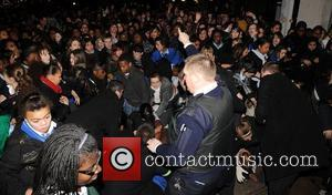 FANS IN JLS-TASY OVER X FACTOR BOYS Steady on girls... In scenes reminiscent of Beatlemania, more than a thousand screaming...