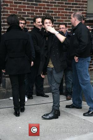 Joe Jonas and Nick Jonas of the Jonas Brothers outside the Ed Sullivan Theater for 'The Late Show with David...