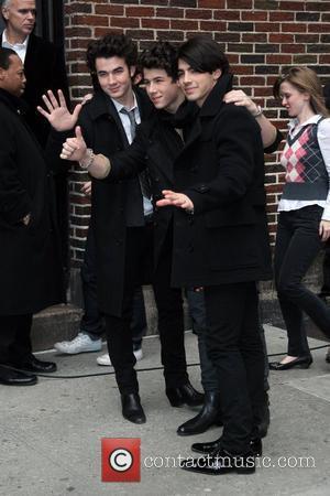 Kevin Jonas, Nick Jonas and Joe Jonas of the Jonas Brothers outside the Ed Sullivan Theater for 'The Late Show...