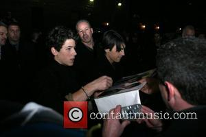 Nick Jonas and Joe Jonas of the Jonas Brothers outside the Ed Sullivan Theater for 'The Late Show with David...