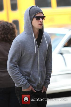 Justin Timberlake wearing a grey hoodie and sunglasses walking in SoHo New York City, USA - 11.05.09
