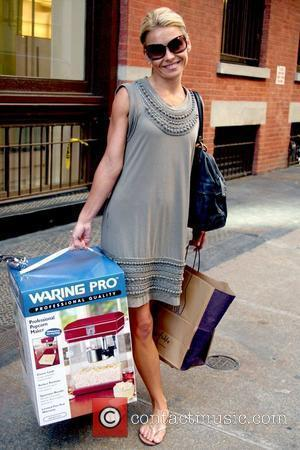 Kelly Ripa shopping in Soho with her children while carrying a professional popcorn maker New York City, USA - 21.05.09