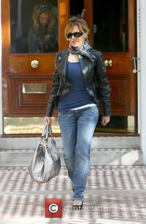 Kylie Minogue leaving her home before stopping at a cafe on her way to the recording studio London, England -...