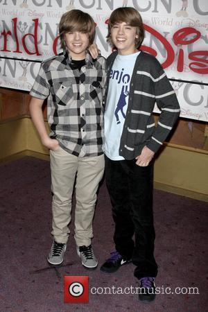 Dylan Sprouse and Cole Sprouse Cast of Disney Channel's Hit Series 'The Suite Life on Deck' meet guests at the...