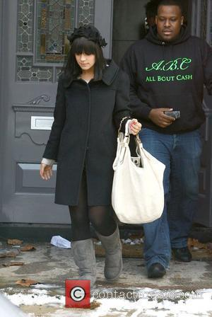 Lily Allen leaves her home with a large security guard before heading into central london  London, England - 03.02.09