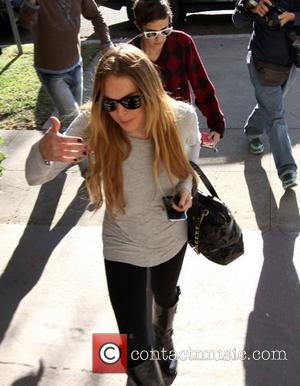 Lohan: 'Family Approves Of Ronson Romance'