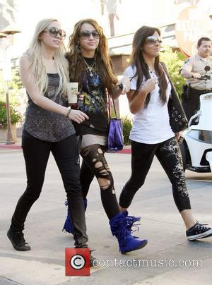 Miley Cyrus and her friends visit a nail salon in North Hollyood Mall. She grabs lunch at Pandera bakery where...