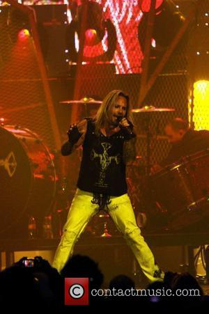 Vince Neil Sued By Law Firm