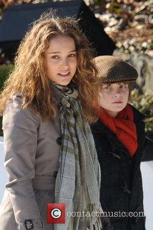 Natalie Portman and Charlie Tahan on the set for 'Love and Other Impossible Pursuits' filming at the Wolman rink in...