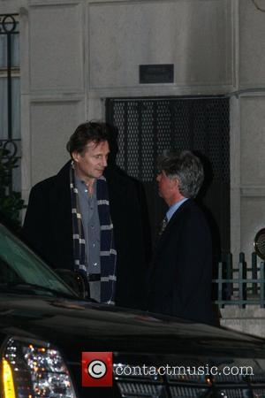 Neeson Faces Public With Pal Fiennes