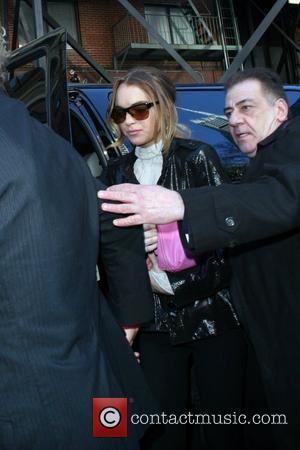 Lohan's Mother Dismisses Tax Bill