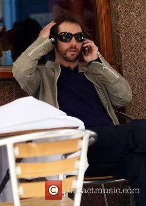 Jason Kay aka J.K. Of Jamiroquai sits outside a cafe on the Portobello road London, England - 08.05.