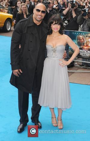 Dwayne Johnson and Carla Gugino