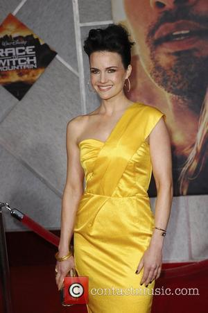 Carla Gugino Premiere of 'Race to Witch Mountain' held at the El Capitan Theatre - Arrivals Los Angeles, California -...