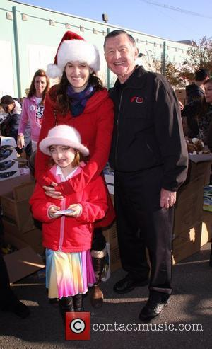 Amy Brenneman and Charlotte Brenneman with Larry Jones The Salvation Army 'Making Miracle' sponsored by Feed The Children and NBPA...