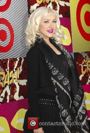 Aguilera 'Blown Away' By New Mum Richie