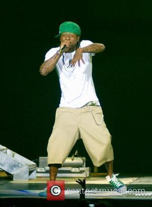 Lil Wayne Keeps His Diamond Teeth Clean