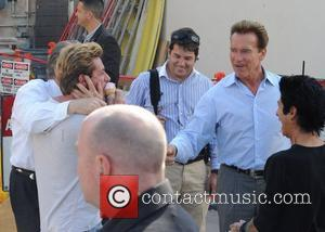 Governor of California Arnold Schwarzenegger makes his way home after having lunch at Mulberry Street Pizzeria with some friends. The...