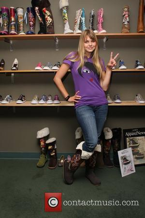 Aimee Teegarden visits an Ed Hardy Outlet Los Angeles, California - 03.06.09