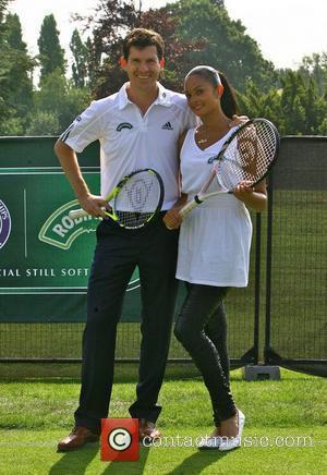 Tim Henman and Alesha Dixon entertain the queueing fans at Wimbledon on the Robinson's Mini-Court. Dixon, who has been touted...