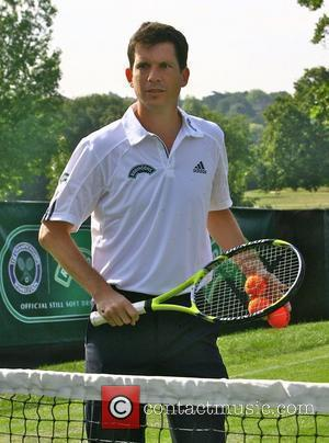 Tim Henman entertains the queueing fans at Wimbledon on the Robinson's Mini-Court. London, England - 22.06.09