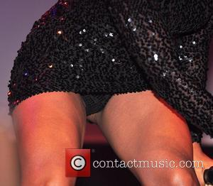 Alexandra Burke sporting a mini dress and matching knickers on show, while performing during the Christmas Lights switching ceremony at...