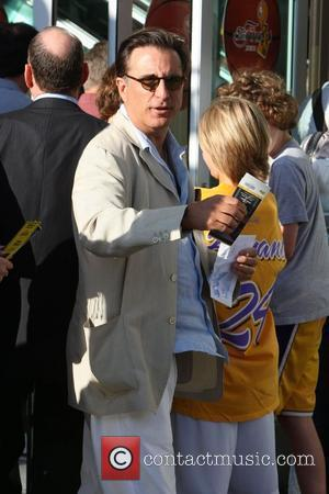 Andy Garcia,  arrive for the first game of the NBA National Championship Tournament between the L.A. Lakers and Orlando...