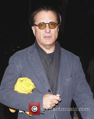 Andy Garcia leaves the Staples Center with a friend after watching the LA Lakers play the Clippers Los Angeles, California...